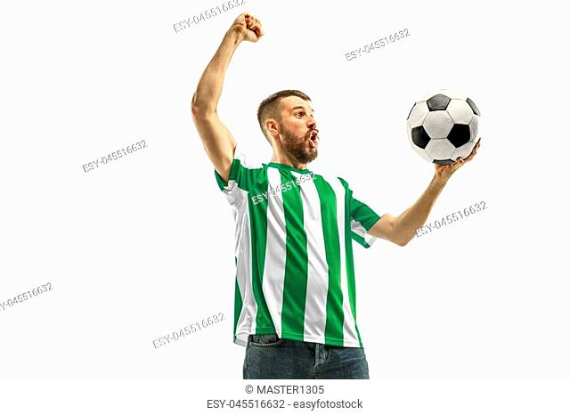 Irish fan celebrating on white background. The young man in soccer football uniform as winner with ball isolated at white studio. Fan, support concept