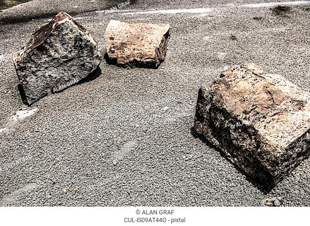 Three large rocks on the ground