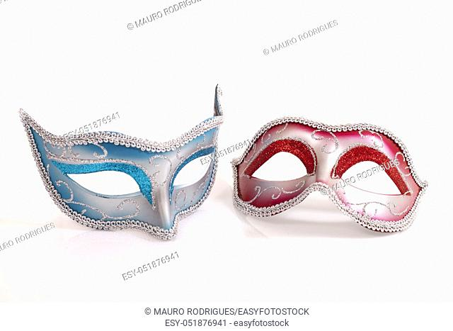 blue and red venetian masks isolated on a white background