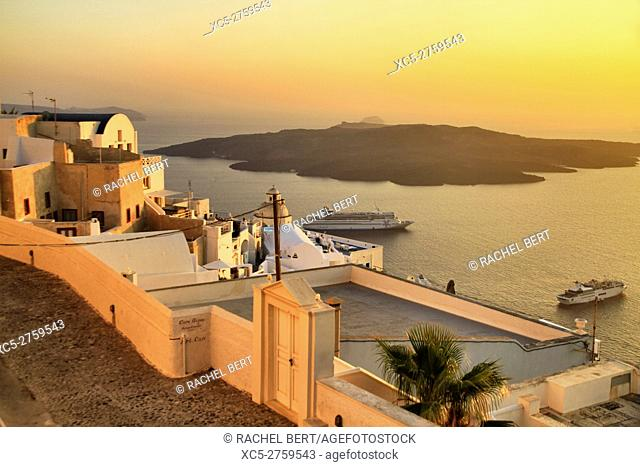 View of the collapsed caldera and Nea Kameni island from Fira at dusk, Santorini/Thera island, Greece