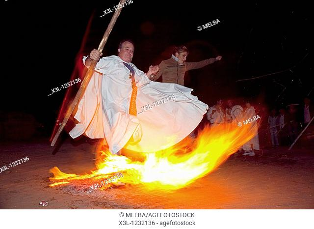 Man is jumping over a fire during Full moon festival in Venta de Tiermes, Soria  Castile-Leon  Spain