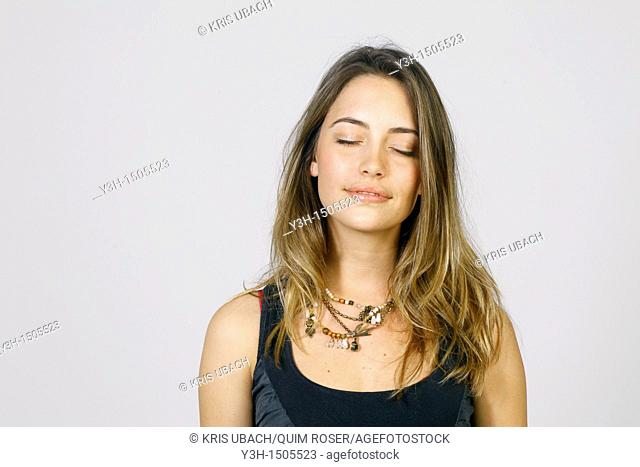 Studio shot of young woman, closed eyes