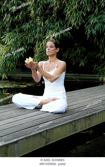 Woman doing yoga - Padmasana Lotus Pose