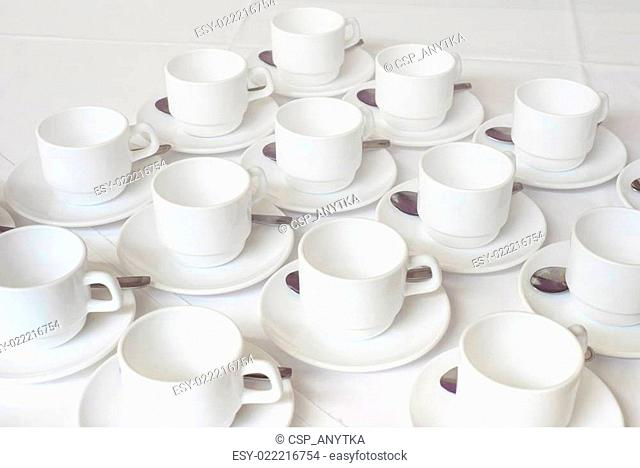 Group of white coffee cups in cafe bar