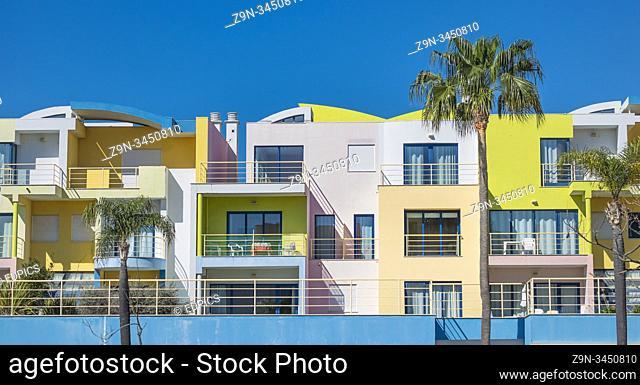 pastel colored postmodern holiday apartment blocks at albufeira marina, albufeira, algarve, portugal