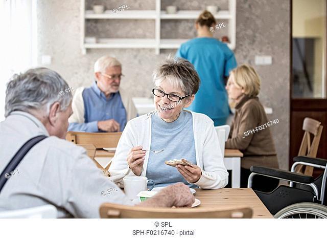 Seniors eating meal