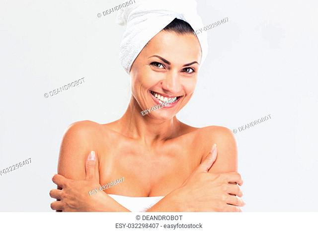 Beauty portrait of a smiling cute woman standing isolated on a white background and looking at camera