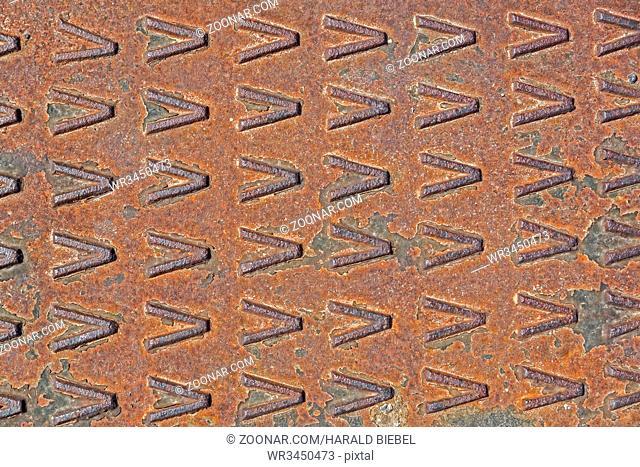 Rostige Eisenplatte mit Muster als Hintergrund