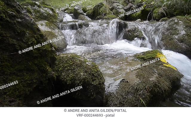 Waterfall in mountain stream, glider shot