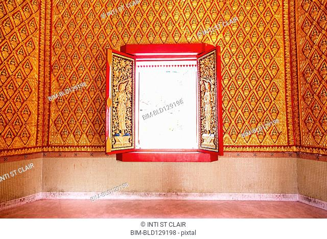 Ornate wall and window in Wat Chayamangkalaram temple, George Town, Penang, Malaysia