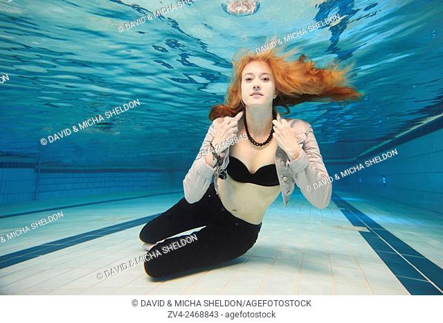 A young woman under water