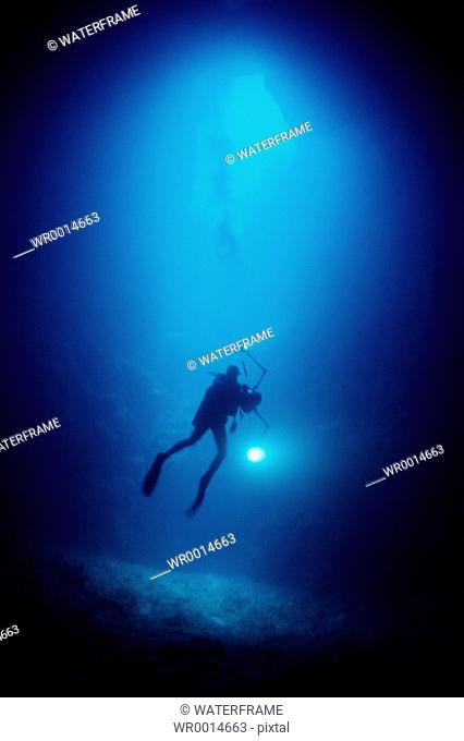 Diver in Blue Hole Cave, Pacific, Micronesia, Palau
