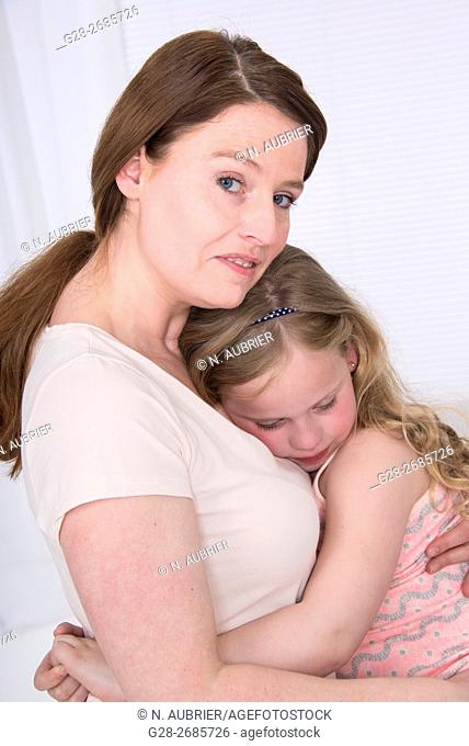 Mother holding tight her little 6 year old child to comfort her