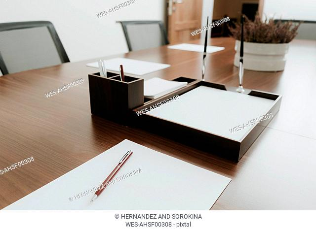 Ballpen and paper on conference table in office