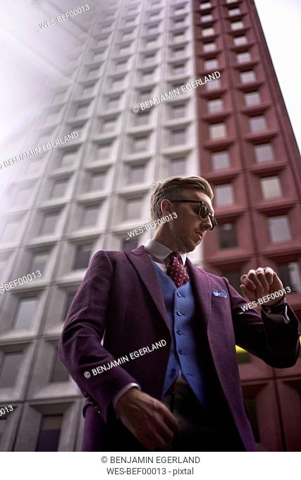 Fashion blogger Steve Tilbrook checking the time