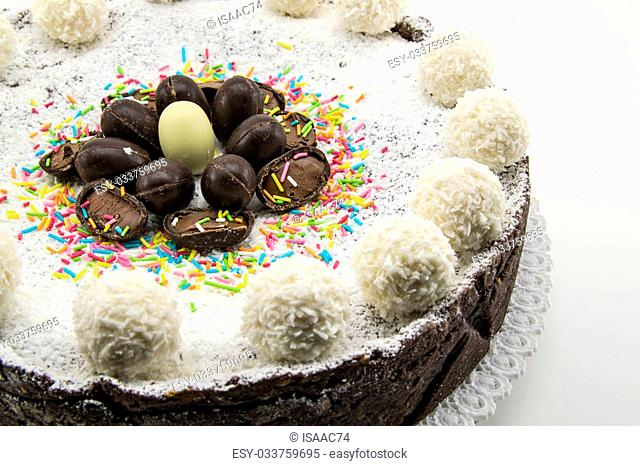 Easter cake with ricotta and chocolate decorated with chocolate eggs and powdered sugar