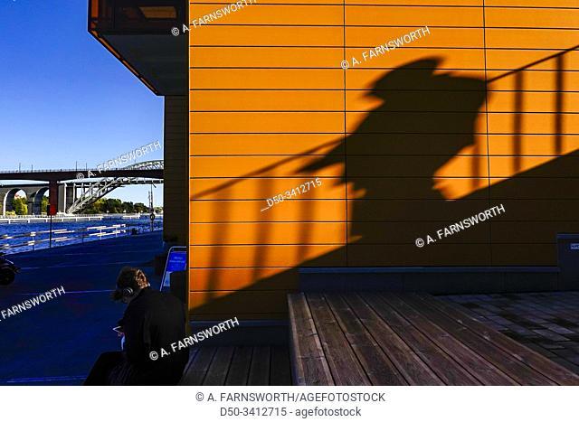 Stockholm, Sweden A man and his shadow at Liljeholmskajen