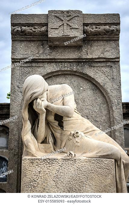 grave sculpture at Poblenou Cemetery in Barcelona, Spain