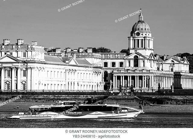 A River Thames Clipper Passes In Front Of The Old Royal Naval College, Greenwich, London, England