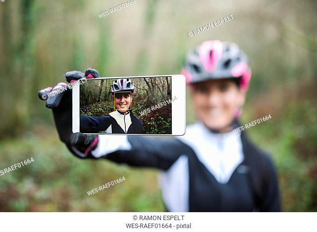 Selfie of smiling female mountain biker