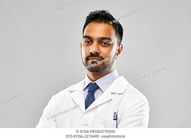 indian doctor or scientist in white coat