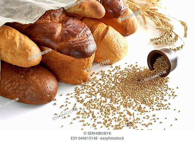 Delicious fresh bread and wheat isolated on white copyspace composition assortment variety