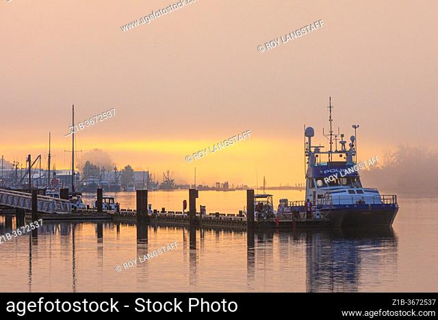 RCMP patrol vessel docked at Steveston on a foggy morning in British Columbia Canada