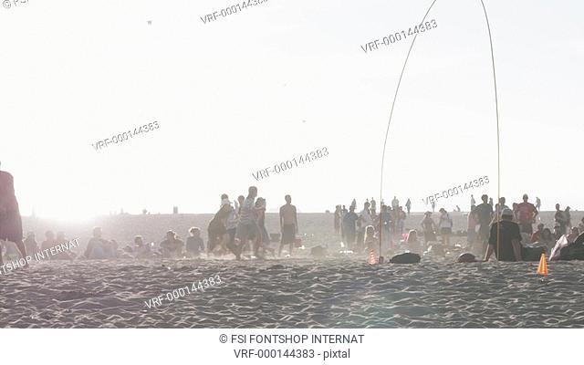 SLO MO, WS, a crowded beach, Los Angeles, California, USA
