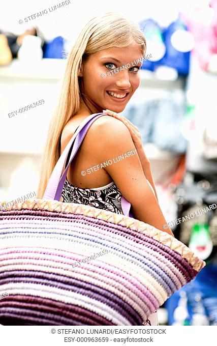Beautiful young woman doing shopping