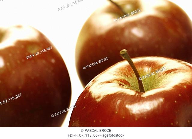 Close-up of three apples