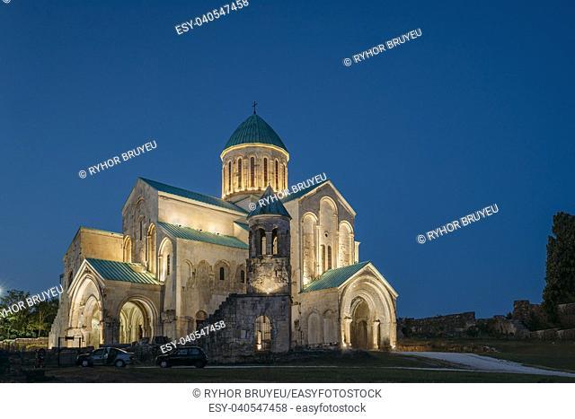 Kutaisi, Georgia. Old Bagrati Cathedral In Night Illuminations. UNESCO World Heritage Site. Famous Landmark, Masterpiece Of The Medieval Georgian Architecture