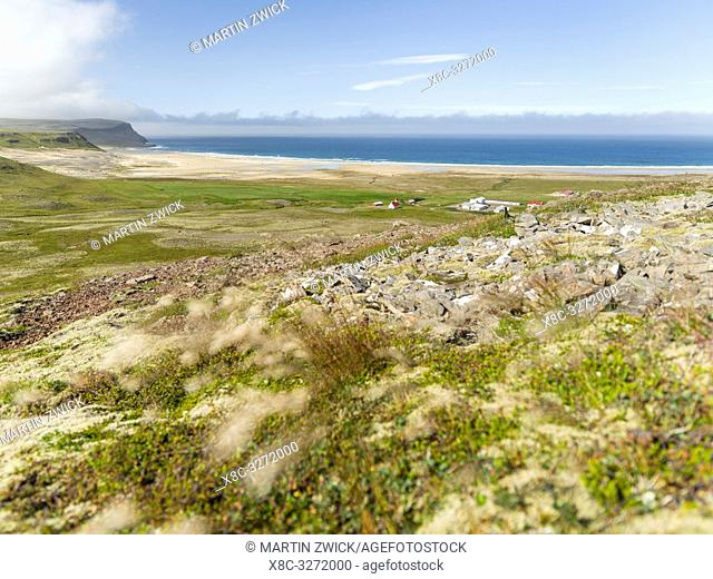Settlement and beach at Breidavik. The remote Westfjords (Vestfirdir) in north west Iceland. Europe, Scandinavia, Iceland