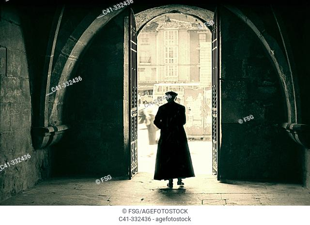 Old priest in cassock