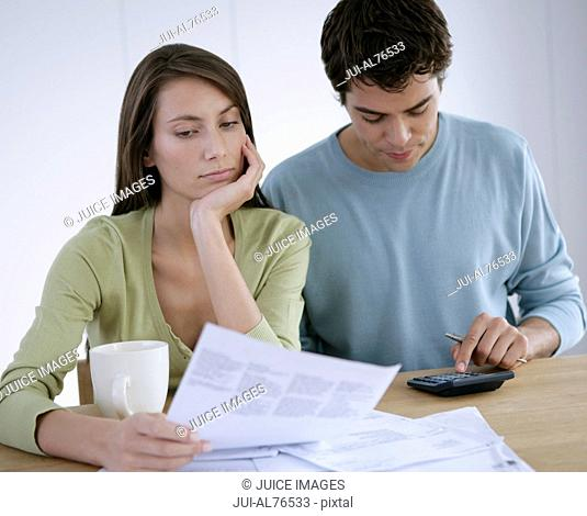 Portrait of a young couple paying bills
