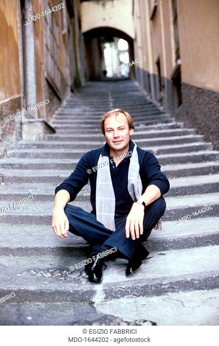 Klaus Maria Brandauer sitting on a flight of steps. The Austrian actor Klaus Maria Brandauer, histrionic performer of various, many-sided roles