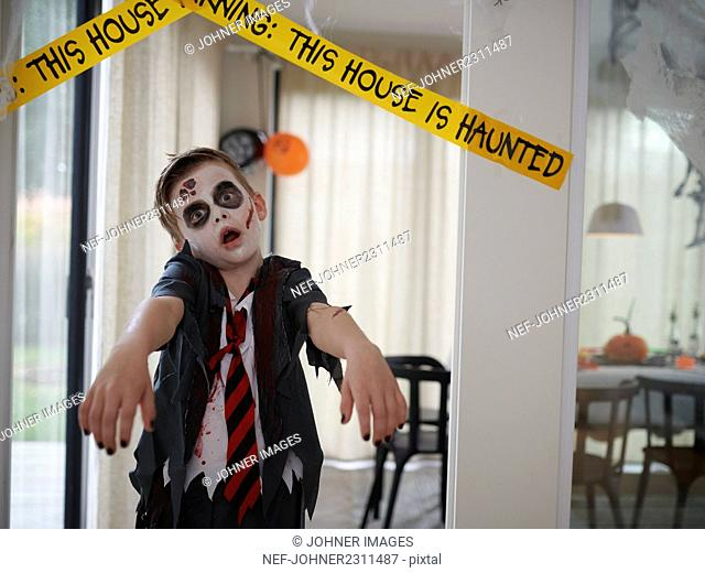 Boy in zombie costume