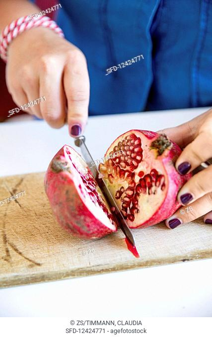 A pomegranate being halved
