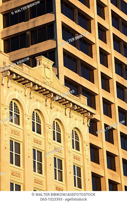 USA, Alabama, Montgomery, old and new buildings on Commerce Street, sunset