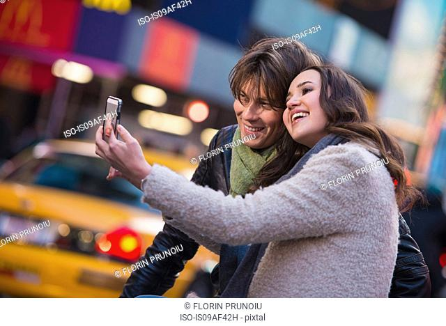 Young couple taking a selfie, New York City, USA