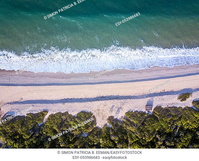Drone picture of the waves hitting the beach on the Swahili Coast, Tanzania