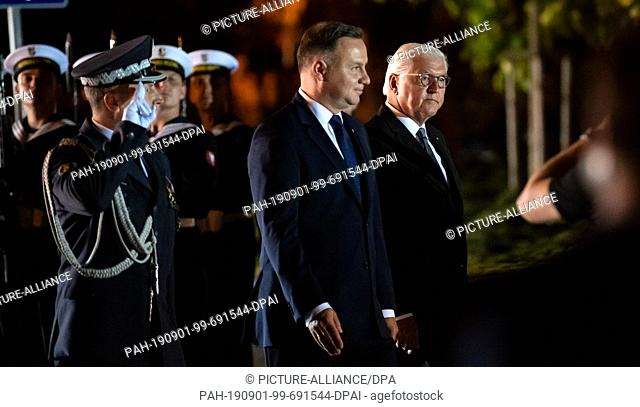 01 September 2019, Poland, Wielun: Federal President Frank-Walter Steinmeier (r) and Polish President Andrzej Duda (2nd from right) take part in a military...