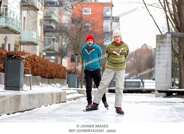 Man and woman ice-skating