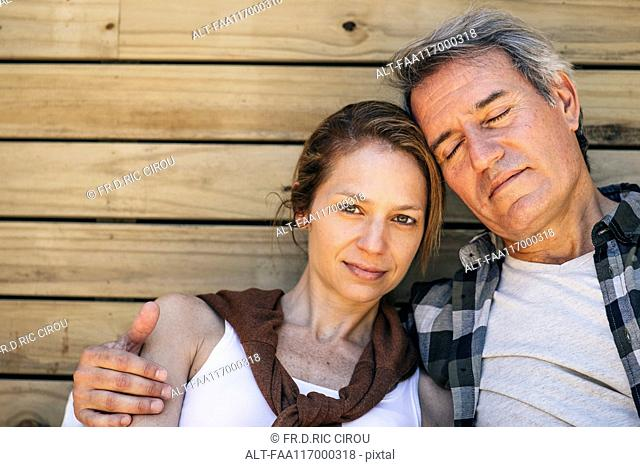 Mature couple sitting outdoors