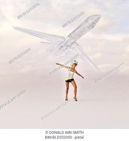 Girl wearing virtual reality goggles imitating airplane