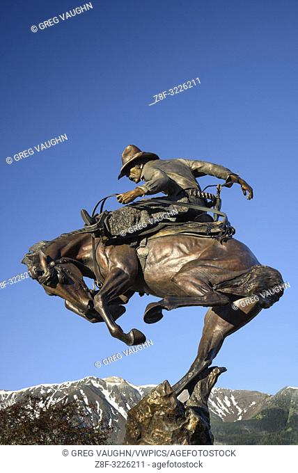 """Attitude Adjustment"" bronze sculpture of cowboy and bucking bronco by Austin Barton in downtown Joseph, Oregon"