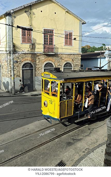 Bonde, Rio's famous electric tram at the stop Largo do Guimaraes; Rio de Janeiro, Espirito Santo, Brazil. The historic street railway has been transporting Rio...