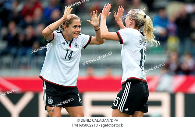 Germany's Mandy Islacker (R) celebrates her 1-0 goal with Anna Blaesse during the women's international soccer match between Germany and the Netherlands in...