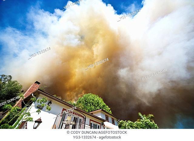 Smoke from Jesusita fire fills sky over house in evacuation zone, Santa Barbara, California, May 6, 2009