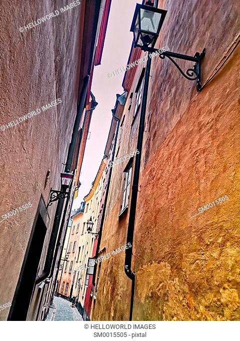 Narrow painted alleyway in Gamla Stan, Stockholm's old town, Stockholm, Sweden, Scandinavia