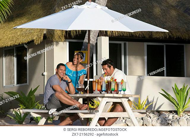 Rarotonga Island. Cook Island. Polynesia. South Pacific Ocean. Sunset on the beach in Hotel Crown Beach Resort & Spa. Lit. Tourists taking photos